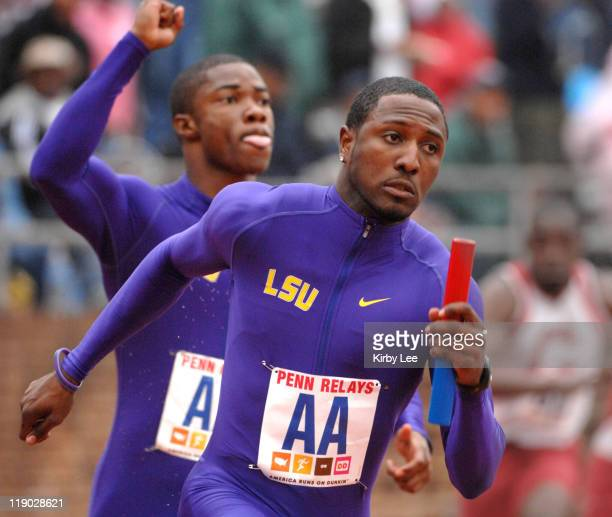 Richard Thompson takes handoff from Marvin Stevenson on the anchor of LSU heatwinning 4 x 100meter relay that timed 4009 in the 113th Penn Relays at...
