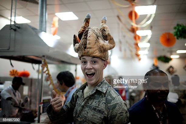 Richard Tuttle from Greensboro NC wears a turkey hat for Thanksgiving at Sather Airforce Base November 24 2011 is the last Thanksgiving US troops...