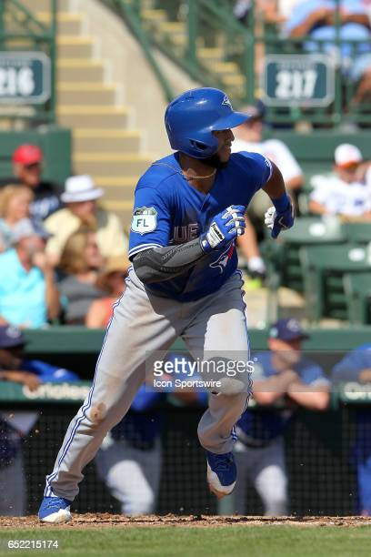 Richard Urena of the Blue Jays hustles to first base during the spring training game between the Toronto Blue Jays and the Baltimore Orioles on March...