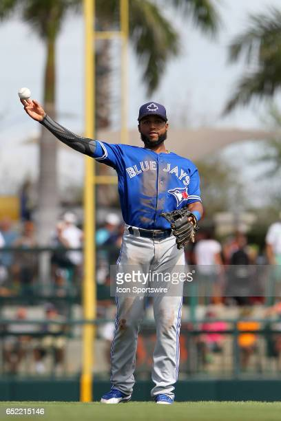 Richard Urena of the Blue Jays throws the ball over to first base during the spring training game between the Toronto Blue Jays and the Baltimore...