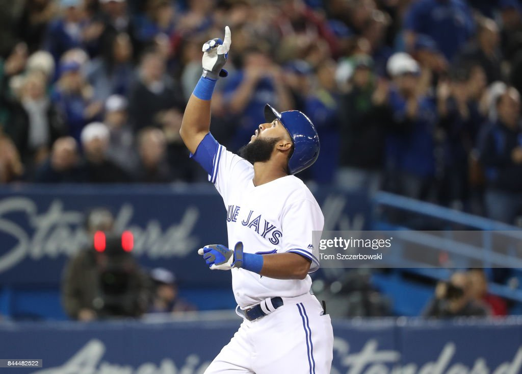 Richard Urena #7 of the Toronto Blue Jays celebrates after hitting a solo home run in the eighth inning during MLB game action against the Detroit Tigers at Rogers Centre on September 8, 2017 in Toronto, Canada.