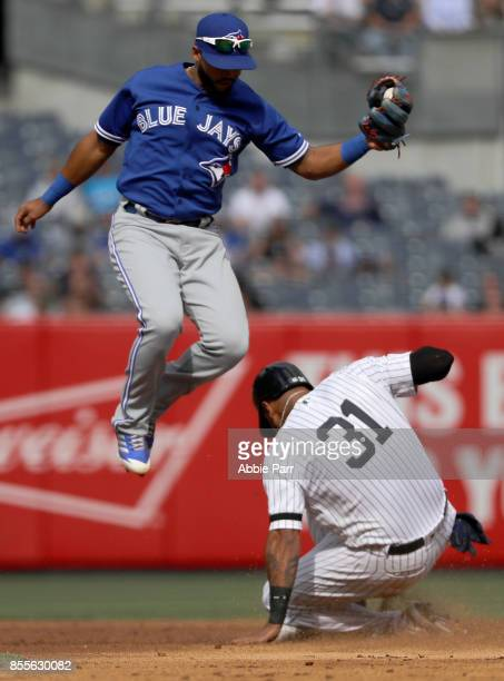 Richard Urena of the Toronto Blue Jays fails to tag out Aaron Hicks of the New York Yankees at second in the fifth inning at Yankee Stadium on...