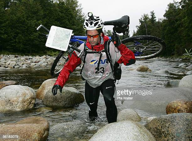 Richard Ussher from the New Zealand team Balance Vector crosses the Giles Creek with his mountain bike on the third day of the Adventure Racing World...