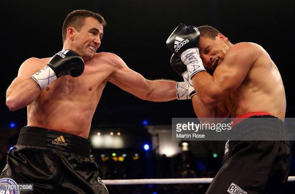 Richard Vidal of Uruguay exchange punches with Eduard Gutknecht of Germany during their WBA Intercontinental light heavyweight title fight at Max...