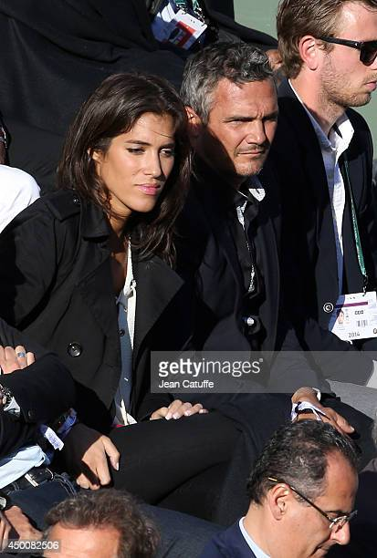 Richard Virenque and Laurie Cholewa attend Day 11 of the French Open 2014 held at RolandGarros stadium on June 4 2014 in Paris France