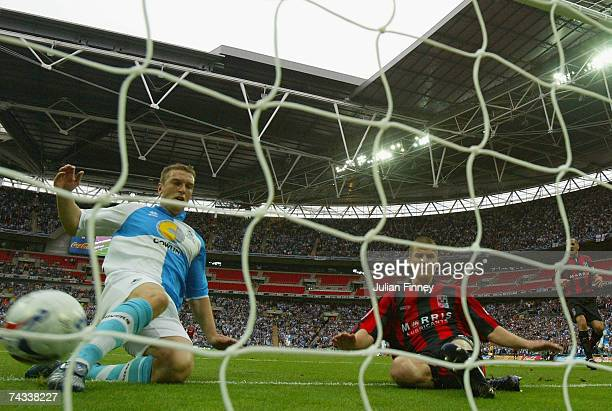 Richard Walker of Bristol Rovers scores his teams second as Rickie Lambert slides in to make sure during the League two Playoff Final match between...