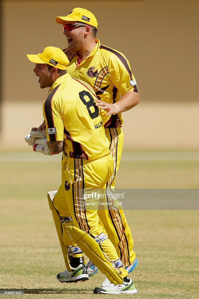Richard Walley (8) and Michael Bailey of Western Australia celebrate a wicket during the National Indigenous Cricket Championships on February 8, 2016 in Alice Springs, Australia.