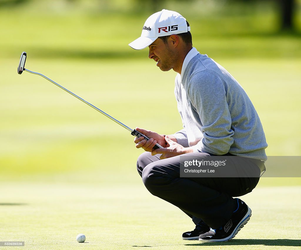 Richard Wallis of Canterbury Golf Club lines up his putt during the Titleist & FootJoy PGA Professional Championship South Qualifier at Woodcote Park Golf Course on May 24, 2016 in Coulsdon, England.