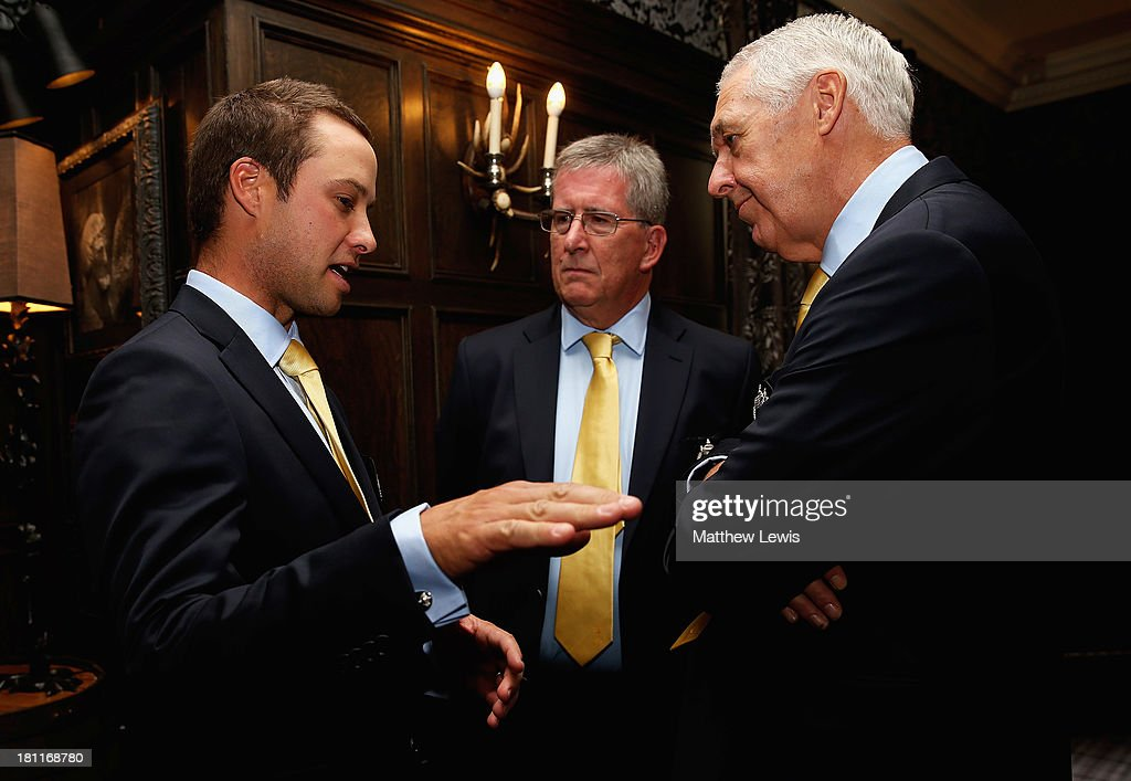Richard Wallis of Great Britain and Ireland talks to John Yapp, Finance Director at the PGA and Nicky Lumb,PGA Captain elect ahead of the opening ceremony ahead of the 26th PGA Cup at De Vere Slaley Hall on September 19, 2013 in Hexham, England.