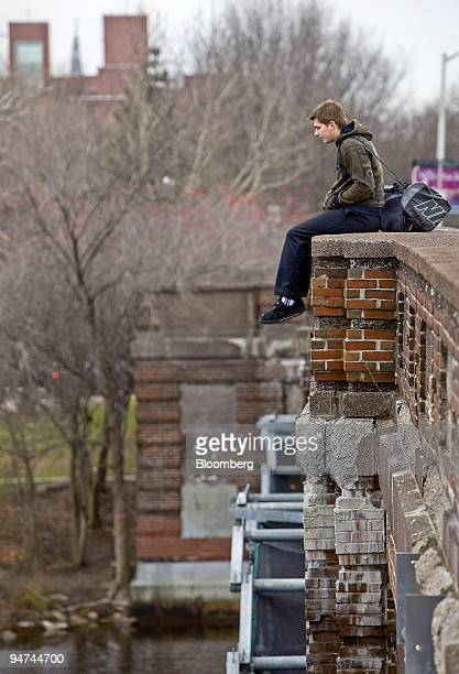 Richard White a Harvard University graduate student sits on the Eliot Street bridge near the school's campus in Cambridge Massachusetts US on Tuesday...
