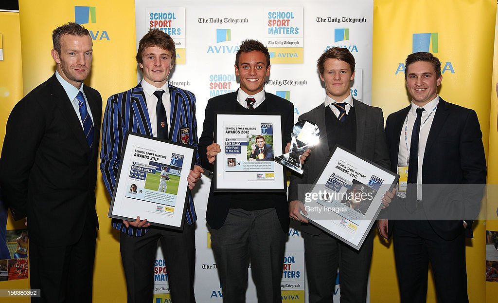 Richard Whitehead (L) and Paul McVeigh (R) pose with Male Pupil of the Year nominees during the AVIVA and Daily Telegraph School Sport Matters awards at Lord's Cricket Ground on November 14, 2012 in London, England.