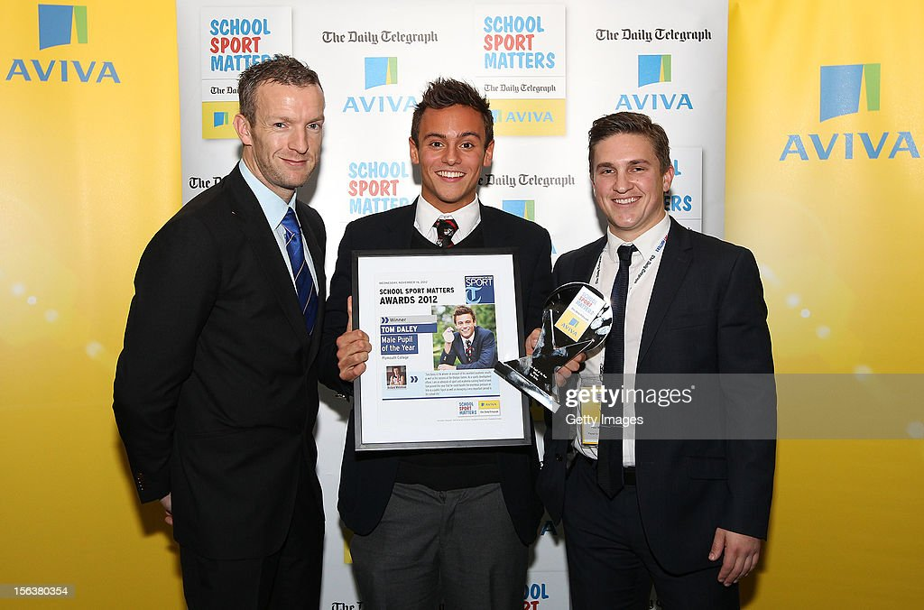Richard Whitehead (L) and Paul McVeigh (R) pose with Male Pupil of the Year winner <a gi-track='captionPersonalityLinkClicked' href=/galleries/search?phrase=Tom+Daley+-+Diver&family=editorial&specificpeople=2652461 ng-click='$event.stopPropagation()'>Tom Daley</a> during the AVIVA and Daily Telegraph School Sport Matters awards at Lord's Cricket Ground on November 14, 2012 in London, England.