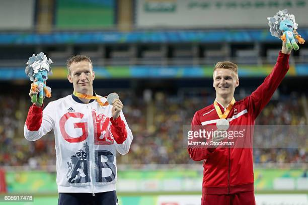 Richard Whitehead of Great Britain and Daniel Wagner of Denmark are awared silver medals after tying in the men's 100 meter T42 final during day 8 of...
