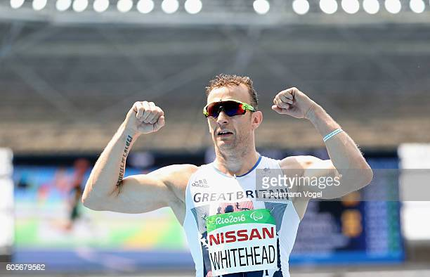 Richard Whitehead of Great Britain celebrates after competing in the Men's 100m T42 Heat 2 on day 7 of the Rio 2016 Paralympic Games at the Olympic...