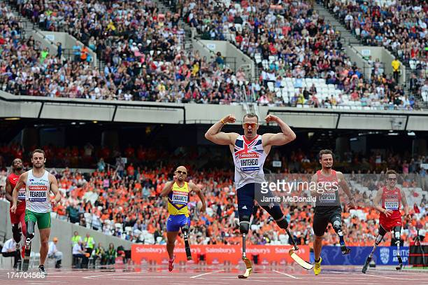 Richard Whitehead of Great Britain celebrates as he crosses the line first in the Men's T42 200mduring day three of the Sainsbury's Anniversary Games...