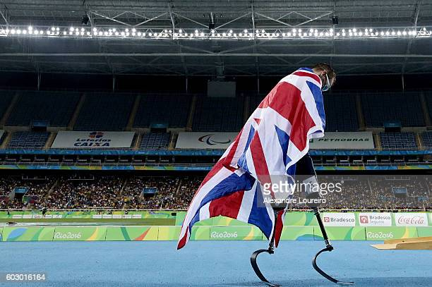 Richard Whitehead of Great Britain celebrates the victory after the Men's 200m T42 Final during day 4 of the Rio 2016 Paralympic Games at the Olympic...