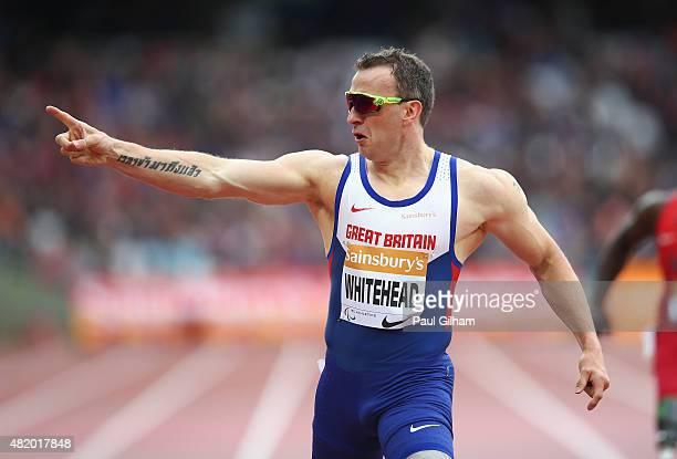 Richard Whitehead of Great Britain celebrates winning the Men's 200m T42 race during day three of the Sainsbury's Anniversary Games at The Stadium...