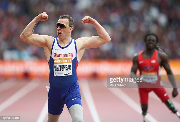 Richard Whitehead of Great Britain celebrates winning the Men's 200m T42 race during day three of the Sainsbury's Anniversary Games at The Stadium...