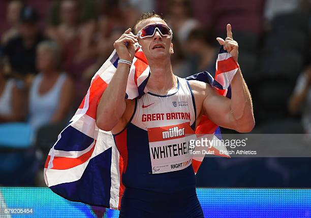 Richard Whitehead of Great Britain celebrates winning the Mens 200m T42 race in a new World Record time during day two of the Muller Anniversary...