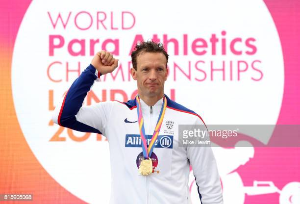 Richard Whitehead of Great Britain poses with his medal after victory in Men's 200m T42 during day three of the IPC World ParaAthletics Championships...