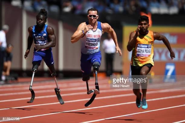 Richard Whitehead of Great Britain Regas Woods Sr of the USA and Anil Prasanna Jayalath Yodha Pedige of Sri Lanka compete in the Men's 100m T42 Round...