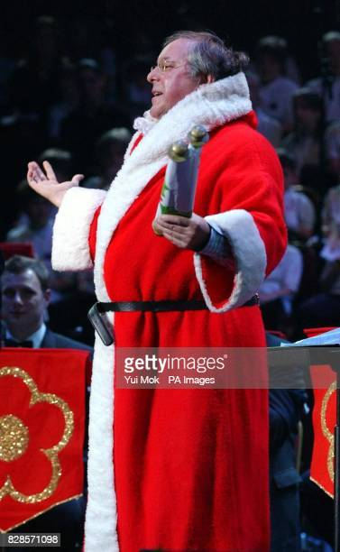 Richard Whiteley dressed as Santa on stage during the TV Times Christmas Carols concert in aid of Leukaemia Research at the Royal Albert Hall in...
