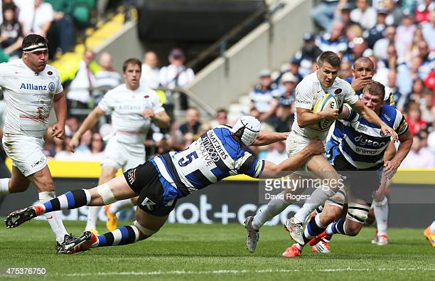 Richard Wigglesworth of Saracens is tackled by Dave Attwood of Bath during the Aviva Premiership Final between Bath Rugby and Saracens at Twickenham...