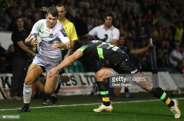 Richard Wigglesworth of Saracens is tackled by Tom Collins during the European Rugby Champions Cup match between Northampton Saints and Saracens at...