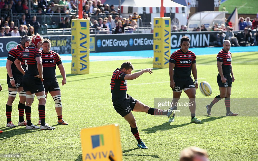 <a gi-track='captionPersonalityLinkClicked' href=/galleries/search?phrase=Richard+Wigglesworth&family=editorial&specificpeople=553815 ng-click='$event.stopPropagation()'>Richard Wigglesworth</a> of Saracens kicks the ball upfield during the Aviva Premiership match between Saracens and Northampton Saints at Allianz Park on April 13, 2014 in Barnet, England.