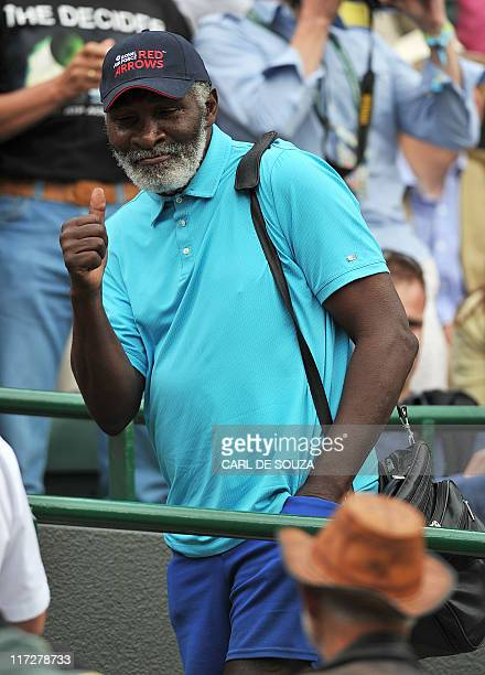 Richard Williams father and coach of US player Venus Williams reacts after she won over Spanish player Maria Jose Martinez Sanchez during the women's...
