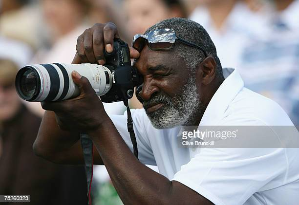 Richard Williams father and coach of Venus Williams of USA takes a photograph following her Women's Singles final match between Marion Bartoli of...
