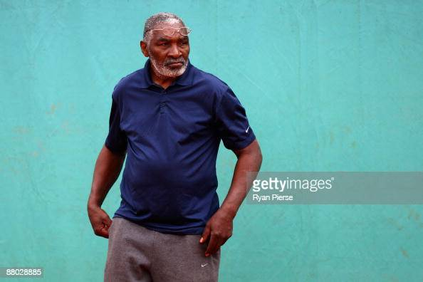 Richard Williams father of Serena Williams of the USA looks on as she trains during day five of the French Open at Roland Garros on May 28 2009 in...