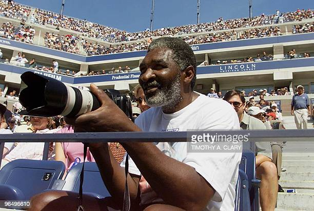 Richard Williams father of tennis players Serena and Venus Williams photographs his daughter Serena during her semifinal match with number one seeded...