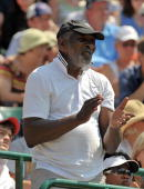 Richard Williams father of US tennis player Venus Williams applauds as his daughter plays against Poland's Agnieszka Radwanska in a Women's Quarter...