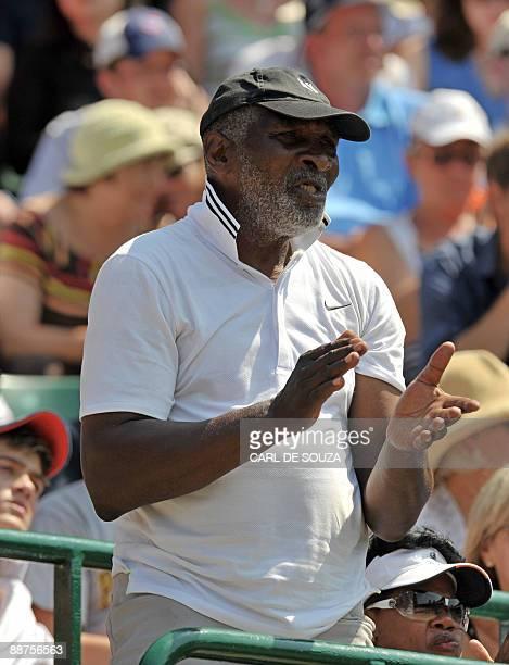 Richard Williams father of US tennis player Venus Williams applauds as his daughter plays against Poland's Agnieszka Radwanska in a Women's Quarter...