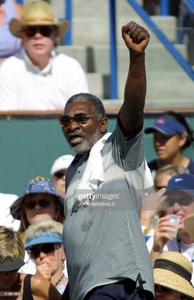 Richard Williams father of US tennis stars Serena and Venus clenches his fist as he and Venus are jeered by the crowd upon their arrival at the...