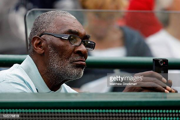 Richard Williams father of Venus Williams of USA takes video during his daughter's first round match against Rossana De Los Rios of Paraguayon Day...