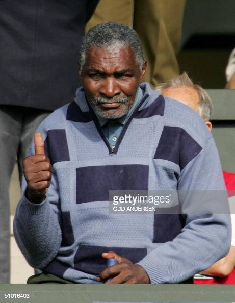 Richard Williams gives his daughter Serena Williams of the US a thumbs up during her semifinal match against Amalie Mauresmo of France at the 118th...