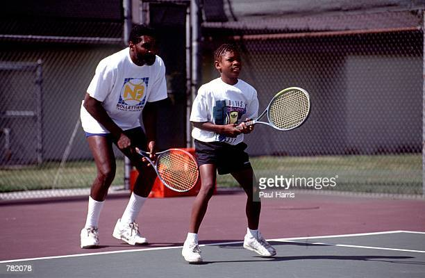 Richard Williams practices with his daughter Serena in 1991 in Compton CA Serena and Venus Williams will be playing against each other for the first...