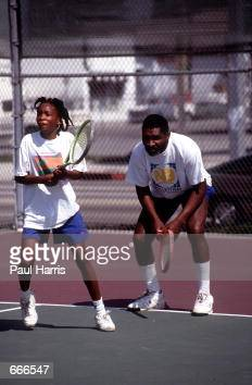 Richard Williams practices with his daughter Venus in 1991 in Compton CA Serena and Venus Williams will be playing against each other for the first...