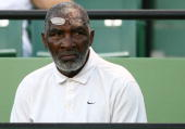 Richard Williams watches as his daughter Venus Williams plays against Iveta Benesova of the Czech Republic during day ten of the Sony Ericsson Open...