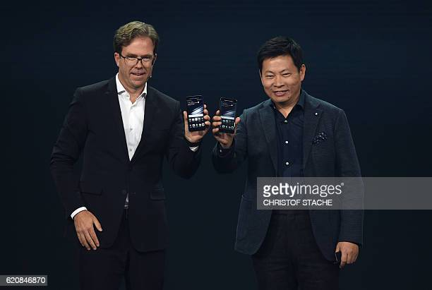 Richard Yu CEO of Huawei Consumer Business Group and Jan Becker Chief Operating Officer of Porsche Design present the new Huawei Mate 9...
