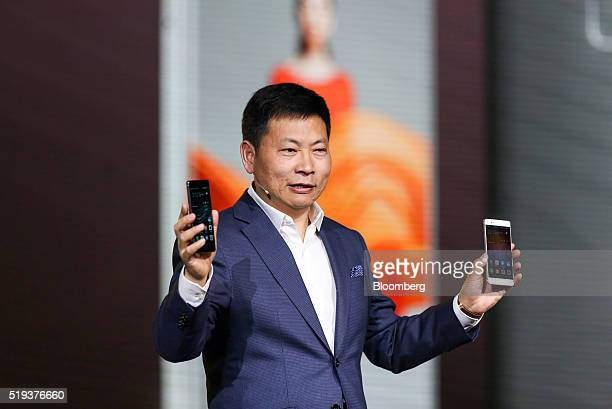 Richard Yu chief executive officer of consumer devices division for Huawei Technologies Co holds a P9 smartphone and a P9 Plus smartphone at a launch...