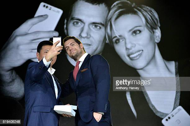 Richard Yu Chief Executive Officer of Huawei Cunsumer Business Group and Henry Cavill attend the Huawei P9 global launch at Battersea Evolution on...