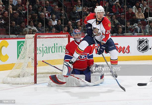 Richard Zednik of the Florida Panthers jumps while screening Carey Price of the Montreal Canadiens during a power play at the Bell Centre on December...