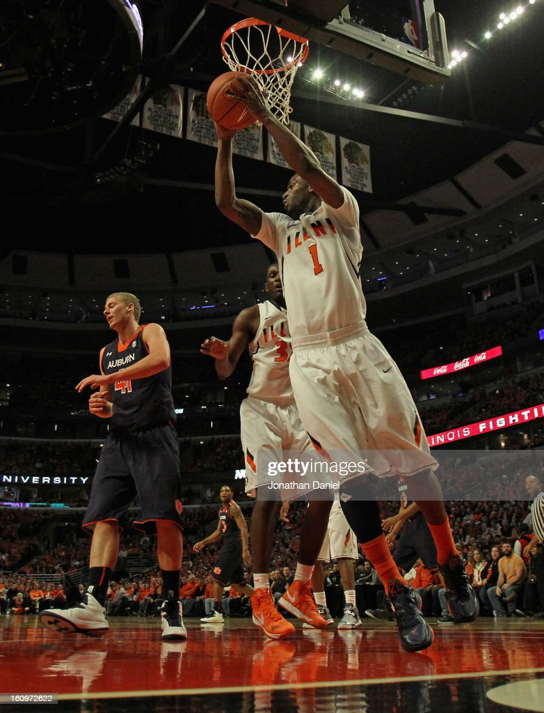 D.J. Richardson #1 of the Illinois Fighting Illini rebounds against the Auburn Tigers at United Center on December 29, 2012 in Chicago, Illinois. Illinois defeated Auburn 81-79.