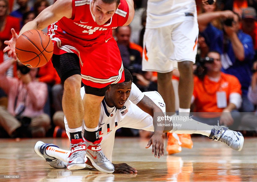 D.J. Richardson #1 of the Illinois Fighting Illini watches as <a gi-track='captionPersonalityLinkClicked' href=/galleries/search?phrase=Aaron+Craft&family=editorial&specificpeople=7348782 ng-click='$event.stopPropagation()'>Aaron Craft</a> #4 of the Ohio State Buckeyes reaches for a loose ball at Assembly Hall on January 5, 2013 in Champaign, Illinois. Ilinois defeated Ohio State 74-55.