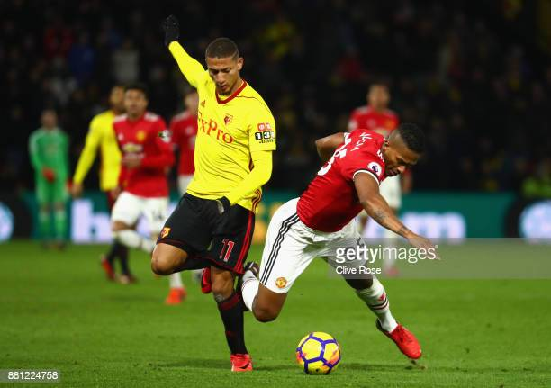 Richarlison de Andrade of Watford and Antonio Valencia of Manchester United in action during the Premier League match between Watford and Manchester...