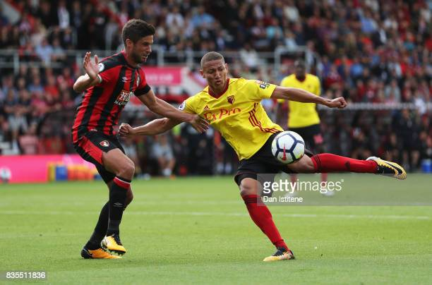 Richarlison de Andrade of Watford and boAndrew Surman battle for possession during the Premier League match between AFC Bournemouth and Watford at...