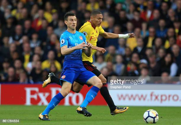 Richarlison de Andrade of Watford and Laurent Koscielny of Arsenal clash during the Premier League match between Watford and Arsenal at Vicarage Road...